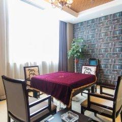 Taihu Xiangting Meicheng Holiday Hotel в номере