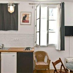 Апартаменты Bp Apartments - Authentic Moulin Rouge Париж в номере фото 2
