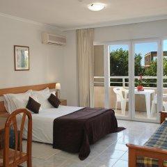 Отель Apartamentos Turisticos Jardins Da Rocha комната для гостей