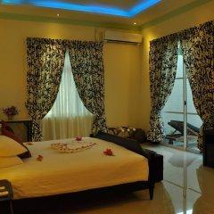 Отель Charming Holiday Lodge Мальдивы, Хулхудху (Атолл Адду) - отзывы, цены и фото номеров - забронировать отель Charming Holiday Lodge онлайн Хулхудху (Атолл Адду) комната для гостей