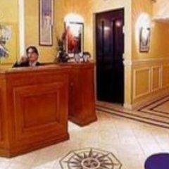 Отель Suites Unic Renoir Saint-Germain Франция, Париж - отзывы, цены и фото номеров - забронировать отель Suites Unic Renoir Saint-Germain онлайн интерьер отеля фото 2