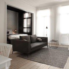 Отель Maison Nationale City Flats & Suites Бельгия, Антверпен - отзывы, цены и фото номеров - забронировать отель Maison Nationale City Flats & Suites онлайн комната для гостей