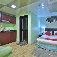 OYO 261 Remas Hotel Apartment Дубай комната для гостей фото 4
