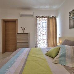 Апартаменты First Class Apartments Calleja by G&G комната для гостей фото 3
