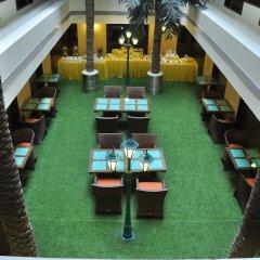 Отель Cambay Grand интерьер отеля фото 3