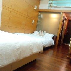 Отель Kunming house сейф в номере