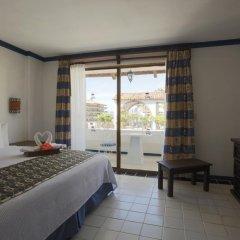 Отель Los Arcos Suites Пуэрто-Вальярта комната для гостей фото 3