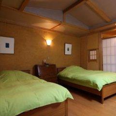 Отель Oyado Nonohana Минамиогуни сейф в номере
