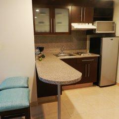 Astur Hotel y Suites в номере