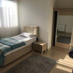 Апартаменты Arma Apartments комната для гостей