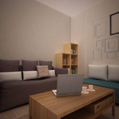Апартаменты Athens Lotus Apartments комната для гостей фото 2