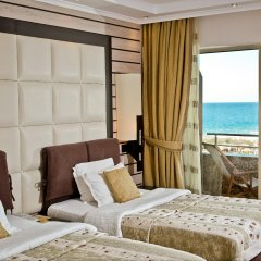 Отель Grand Hotel Pomorie Болгария, Поморие - 2 отзыва об отеле, цены и фото номеров - забронировать отель Grand Hotel Pomorie онлайн комната для гостей фото 2