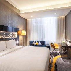 Отель Novotel Singapore on Stevens комната для гостей фото 4