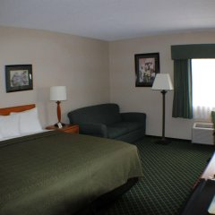 Отель All Seasons Inn and Suites комната для гостей фото 4