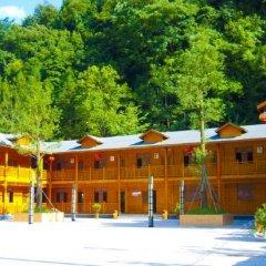 Muwu Holiday Hotel вид на фасад