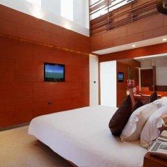 Отель La Flora Resort Patong комната для гостей фото 7