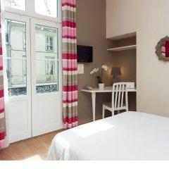 Qualys Le Londres Hotel Et Appartments Сомюр в номере