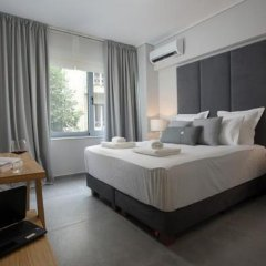 Апартаменты LeGeo-Luxurious Athenian Apartment комната для гостей фото 4