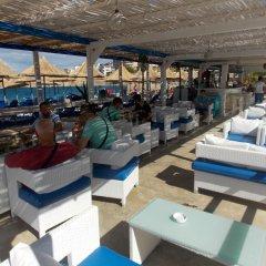 Отель Sunset Suites Албания, Саранда - отзывы, цены и фото номеров - забронировать отель Sunset Suites онлайн пляж