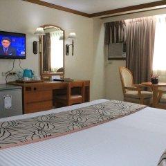 Отель Palm Grove Hotel Филиппины, Манила - отзывы, цены и фото номеров - забронировать отель Palm Grove Hotel онлайн удобства в номере фото 2