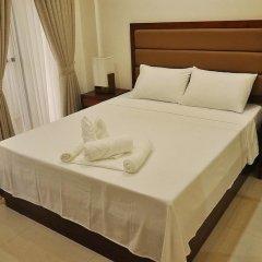 Отель Rishan Village Residences Филиппины, Пампанга - отзывы, цены и фото номеров - забронировать отель Rishan Village Residences онлайн комната для гостей фото 2
