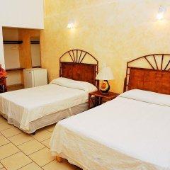 Отель Casa Sun And Moon Сиуатанехо комната для гостей