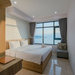 Апартаменты Handy Beachfront Apartment Нячанг комната для гостей фото 4