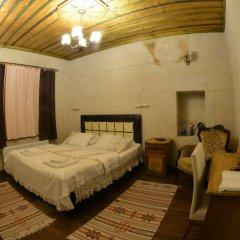 Отель Amor Cave House сейф в номере