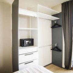Отель Smartflats Design - L42 сейф в номере