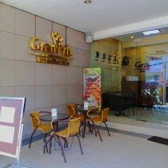 Отель Gran Prix Hotel & Suites Cebu Филиппины, Себу - отзывы, цены и фото номеров - забронировать отель Gran Prix Hotel & Suites Cebu онлайн интерьер отеля
