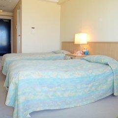 Отель Ocean Resort PMC Япония, Центр Окинавы - отзывы, цены и фото номеров - забронировать отель Ocean Resort PMC онлайн комната для гостей фото 4