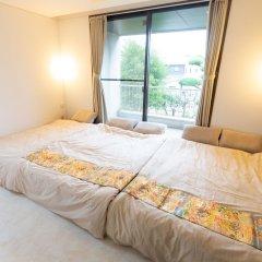 Отель GUESTHOUSE HAKOZAKI GARDEN - Hostel Япония, Фукуока - отзывы, цены и фото номеров - забронировать отель GUESTHOUSE HAKOZAKI GARDEN - Hostel онлайн комната для гостей фото 2
