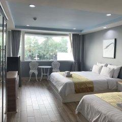 Отель The Beach Front Resort Pattaya комната для гостей фото 4
