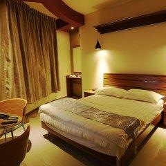 Отель Batuta Maldives Surf View Guest House Мале сейф в номере