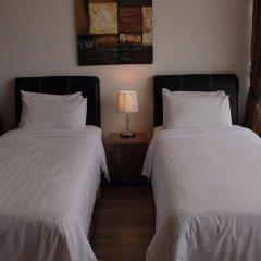 Отель 1 Borneo Tower B Service Condominiums комната для гостей