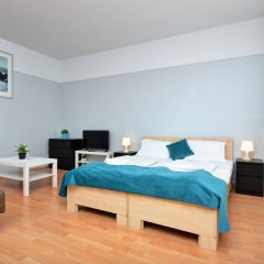 Апартаменты Agape Apartments комната для гостей фото 10