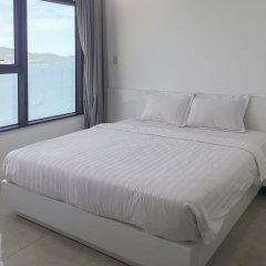 Апартаменты Sunrise Ocean View Apartment Нячанг комната для гостей фото 5