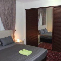 Отель Beautiful 2 BR Apt Quiet & Private Иордания, Амман - отзывы, цены и фото номеров - забронировать отель Beautiful 2 BR Apt Quiet & Private онлайн комната для гостей фото 5