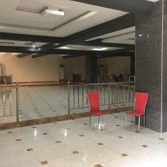 Отель Ritz-Carinton Suites Нигерия, Энугу - отзывы, цены и фото номеров - забронировать отель Ritz-Carinton Suites онлайн интерьер отеля