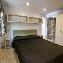 Отель Flaminio Village Bungalow Park комната для гостей фото 3