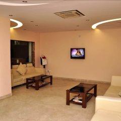 Отель Apra International Индия, Нью-Дели - отзывы, цены и фото номеров - забронировать отель Apra International онлайн комната для гостей фото 3