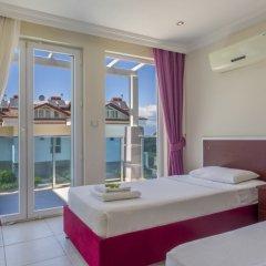Апартаменты Orka Royal Hills Apartment Олудениз комната для гостей фото 5