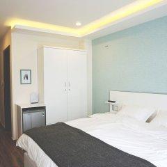 Shinhua Hotel комната для гостей фото 2