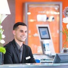 Отель Novotel Genève Aéroport France Франция, Ферней-Вольтер - отзывы, цены и фото номеров - забронировать отель Novotel Genève Aéroport France онлайн интерьер отеля