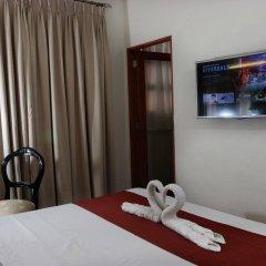 Отель 1775 Adriatico Suites Филиппины, Манила - отзывы, цены и фото номеров - забронировать отель 1775 Adriatico Suites онлайн удобства в номере