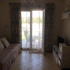 Апартаменты Cozy Apartment on the beach line комната для гостей фото 4