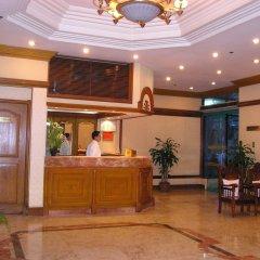 Отель Citadel Inn Makati Филиппины, Макати - отзывы, цены и фото номеров - забронировать отель Citadel Inn Makati онлайн интерьер отеля фото 2