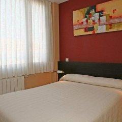 Отель Apartamentos Playa de Portio Испания, Пьелагос - отзывы, цены и фото номеров - забронировать отель Apartamentos Playa de Portio онлайн комната для гостей