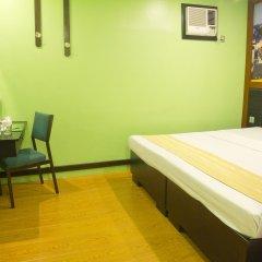 Отель Eurotel Makati Филиппины, Макати - отзывы, цены и фото номеров - забронировать отель Eurotel Makati онлайн комната для гостей фото 2