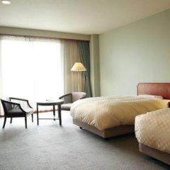 Отель Kadoman Япония, Минамиогуни - отзывы, цены и фото номеров - забронировать отель Kadoman онлайн комната для гостей